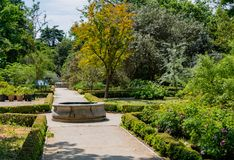 Gardens of Madrid with fountains and walks Stock Image