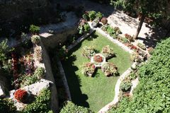 Gardens in Monasteries in Greece. Gardens with different flowers in Monasteries on Meteora Rocks, Trikala region, Greece royalty free stock photography