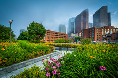 Gardens at North End Park with view of buildings in downtown in Stock Photo