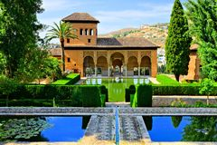 Gardens of the Partal Palace at the Alhambra, Granada, Spain. Gardens and reflective pools of the Partal Palace at the Alhambra, Granada, Spain Royalty Free Stock Photography