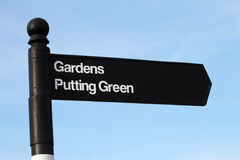 Gardens and putting green sign Royalty Free Stock Images