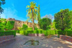 Gardens of Royal Alcazar in Seville and Grotto Gallery  Galeria. Seville, Spain - June 09, 2017 : View of big and beautiful garden - Gardens of Royal Alcazar in Stock Photography