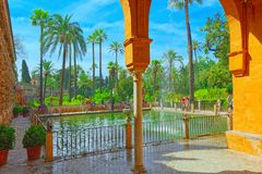 Gardens of Royal Alcazar in Seville and Grotto Gallery  Galeria. Seville, Spain - June 09, 2017 : View of big and beautiful garden - Gardens of Royal Alcazar in Royalty Free Stock Photography