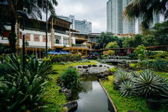 Gardens and skyscrapers at Greenbelt Park, in Ayala, Makati, Met stock photos