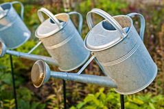 Gardering. Watering pots in the garden royalty free stock images