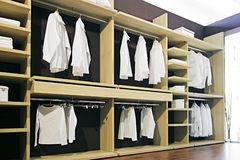 Garderobe. White shirt in the garderobe Stock Photos
