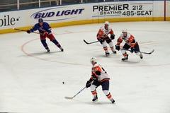 gardes forestiers d'insulaires de glace d'hockey de jeu X Photo stock