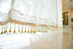 gardinen snör åt Arkivbild