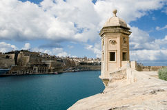 The Gardjola, Valletta, Malta. The Gardjola along blue waters of coastline of Valletta, Malta on sunny day Stock Images