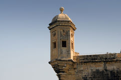 Gardjola watch tower. The Gardjola watchtower , at the edge of the bastions overlooking the Grand Harbour of Valletta, Malta. There is an eye and an ear at the Royalty Free Stock Images