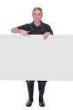 Gardner masculino maduro que lleva a cabo el cartel Fotos de archivo