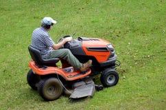 Gardner on ride-on lawn Royalty Free Stock Photos