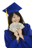 Asian teenage in blue graduation gown holding US money Royalty Free Stock Photo