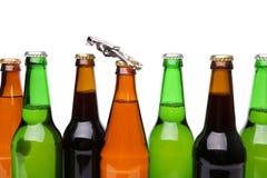 Gargalos diferentes com um abridor de garrafa Imagens de Stock