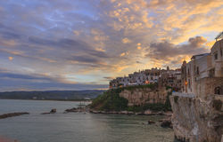 Gargano coast: bay of Vieste.-(Apulia) ITALY-Panoramic view of the old city at sunset. Royalty Free Stock Photos