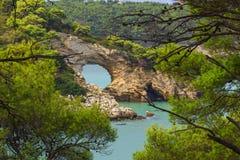 Apulia coast: Gargano National Park, San Felice arch (Architello), Italy,Vieste. Royalty Free Stock Photo