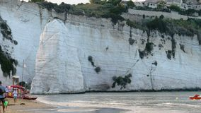 Vieste beach Gargano seacost scenic white Pizzomunno skerry rock sunset stock video footage
