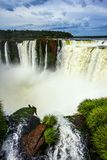 The Garganta del Diablo/ Devil`s Throat. Is the most grandiose part of the Iguazu Falls on the Parana River. Concept of active and extreme tourism Royalty Free Stock Photo