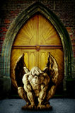 Gargoyle. A statue of gargoyle guarding a temple gate Stock Photos