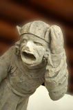 Gargoyle. Close-up of gargoyle figure, Europe. In architecture, a gargoyle is a carved stone grotesque with a spout designed to convey water from a roof and away Royalty Free Stock Photos