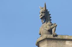 A Gargoyle against a blue sky. Royalty Free Stock Photo