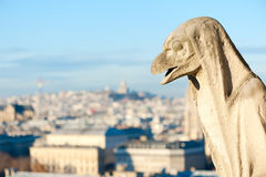 Gargoyle against blue sky - Paris Royalty Free Stock Photo