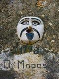 Gargoyle with Anonymous mask Stock Images