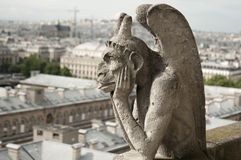 Gargoyle At Notre-Dame Cathedral, Paris Stock Photo