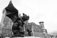 Gargoyle and Castle in Black and White Stock Image