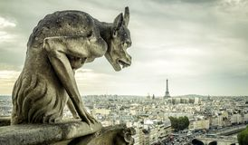 Gargoyle on the Cathedral of Notre Dame de Paris looks at the Ei stock photo