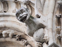 Gargoyle and chimera of Notre Dame Cathedral, Paris. Close-up of Chimera on the top of Notre Dame Stock Photography