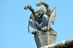 Gargoyle. Daemon sit on a roof of a building royalty free stock image