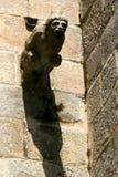 A gargoyle decorates the facade of a church (France). A gargoyle decorates the facade of Saint-Malo church in Dinan, France, on May 8, 2009. Une gargouille dé royalty free stock photos