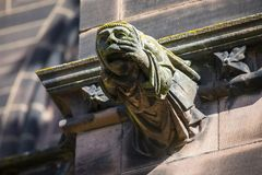 Gargoyle at Chester Cathedral. A gargoyle on the exterior of Chester Cathedral, in the historic city of Chester in Cheshire, UK royalty free stock photos