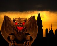 Gargoyle with Gothic Background Stock Images