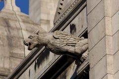 Gargoyle i Sacren Coeur, Montmarte, Paris Arkivfoton