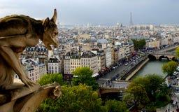 Gargoyle looking over the Paris skyline Royalty Free Stock Photos