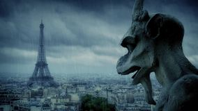 Gargoyle Looks Over Paris In The Rain stock footage