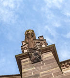 Gargoyle made of Sandstone at Freiburg Minster. Gargoyle witgh grimace at Freiburg Minster Royalty Free Stock Images