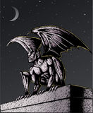 Gargoyle at night Stock Image