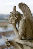 Gargoyle on Notre Dame Cathedral Stock Photos