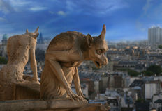 Gargoyle of Notre Dame de Paris. Chimera in gothic style is watching over Paris from top of Notre Dame cathedral royalty free stock photography
