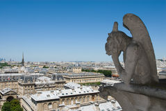 Gargoyle of Notre Dame de Paris. Gorgoyle of Notre Dame de Paris, look down from the roof of the cathedral Stock Photos