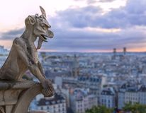 Gargoyle on Notre Dame In Paris at sunset Royalty Free Stock Photo