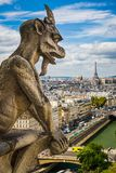 Gargoyle on Notre Dame with skyline of Paris royalty free stock photography