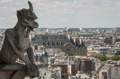 Gargoyle over Paris Stock Photos