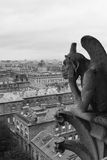 Gargoyle overlooking Paris Stock Photo