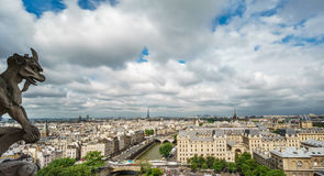 Gargoyle of Paris on Notre Dame Cathedral church and Paris cityscape Stock Photography