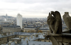 Gargoyle and Sacre Coeur. Paris`s view from the top of Notre Dame de Paris. Gargoyle and Sacre Coeur Royalty Free Stock Images