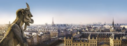 Gargoyle statue and Panoramic view of Paris from Notre Dame Cathedral Stock Photos